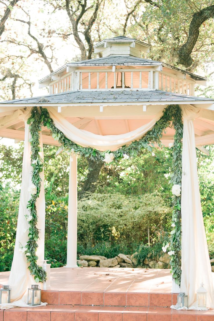 Ethereal Wedding Ceremony Decor Idea   Outdoor Ceremony With Greenery +  White Fabric Arch {Photo