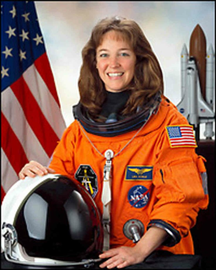 Lisa Nowak Proving that female astronauts can have long, pony hair AND those airy 90s bangs. (diaper not picture)