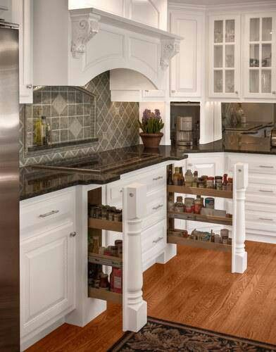 Great storage idea for spices, etc next to the cook top. Built in Spice racks Gourmet Kitchen www.OakvilleRealEstateOnline.com