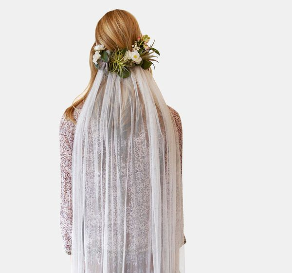 Getting married in a rustic chic ceremony in the middle of a woodsy wonderland? This flowing veil accented with flowers would look gorgeous with a more relaxed wedding dress and minimal accessories. For more inspiration for your bridal look, check out #mywedding: www.mywedding.com/dresses/