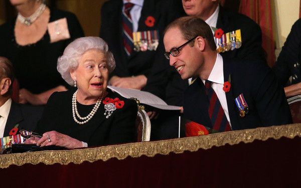 Queen Elizabeth II Photos - Queen Elizabeth II holds up her glasses after joking with Prince William, Duke of Cambridge in the Royal Box at the Royal Albert Hall during the Annual Festival of Remembrance on November 7, 2015 in London, England. - The Royal Family Attends the Annual Festival of Remembrance