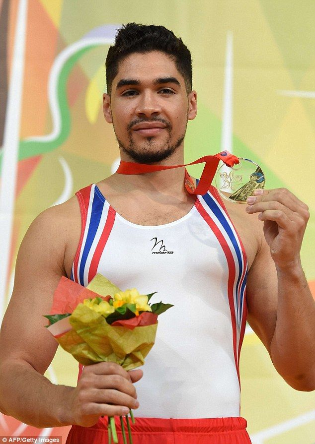 Triumphant: Louis Smith shows off his gold medal at the European Gymnastics Championships ...