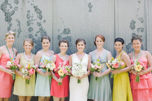 different colors but they all coordinate & big necklaces. unique bridesmaid dresses