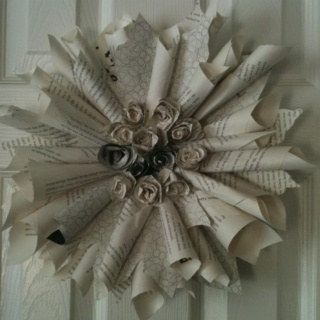 Sunburst door decoration from old book pages.