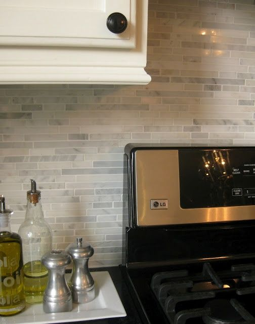 Gorgeous backsplash for new kitchen! #5thWaLL A Marble Backsplash with grey cabinets would look great!