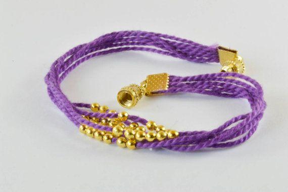 $12 purple and gold Bracelet