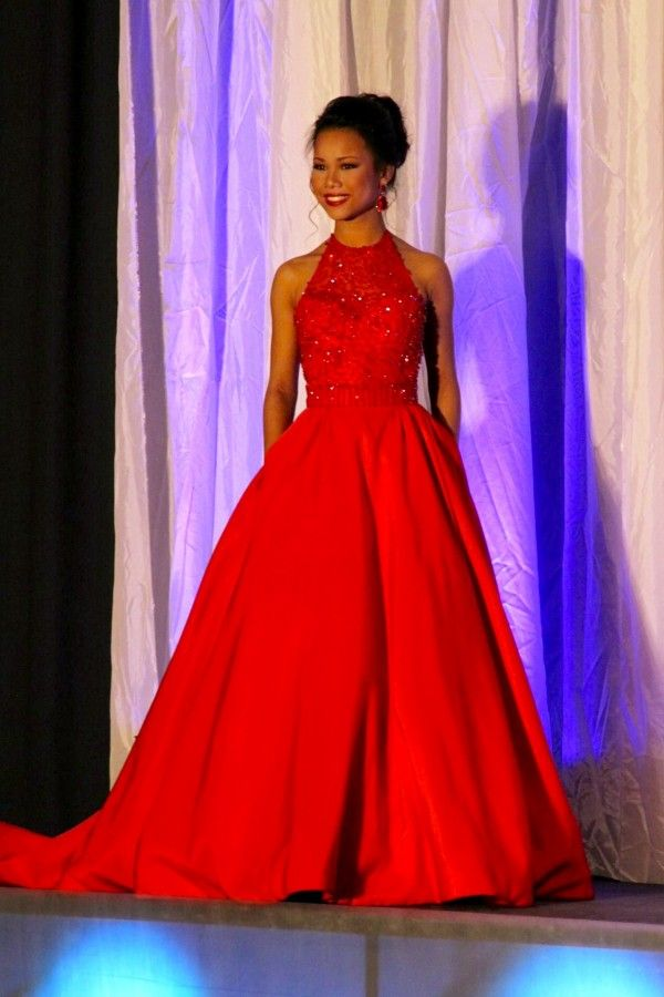 Lydia Martin recently wore this gorgeous red Sherri Hill ball gown when she represented Miss North Jefferson Area at the Miss Alabama's Outstanding Teen 2016 Pageant!  Want to see a Miss America's Outstanding Teen evening gown?   The Color -   This bright red color is such a great choice for Lydia as it accents her bronzed skin tone and darker facial features impeccably! This red's brighter tone is also perfect for a teen contestant as it is fun and flirty while still being a very regal and…