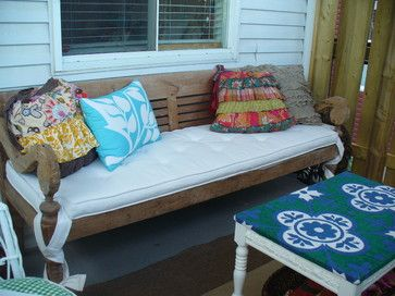 spray paint old metal futon frame with bright color and cover futon with bright patterned fabric