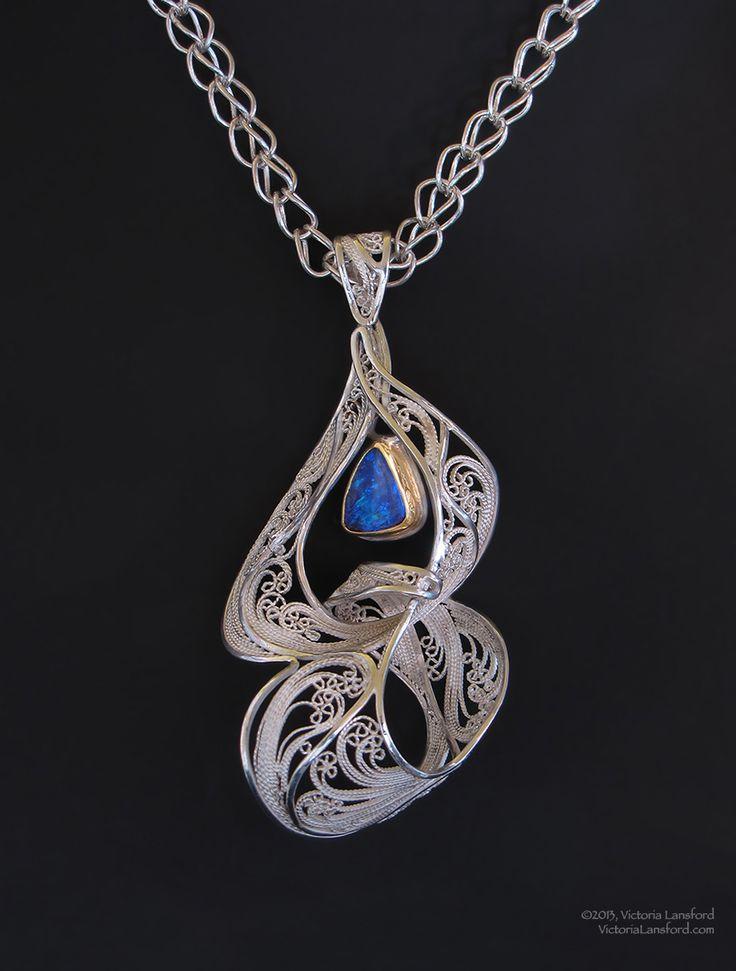 "Necklace | Victoria Lansford. ""Entwine VI"". Russian filigree pendant; 22k gold, sterling silver, fine silver, Koroit opal on a Roman chain."