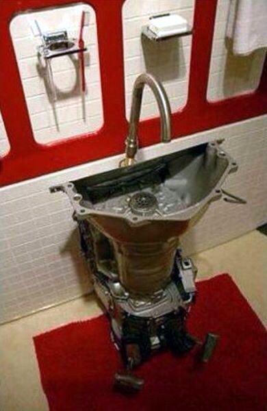 """Garage or """"His"""" bathroom sink alternative. I think this is the transmission from a car or truck. My guy would love this!"""