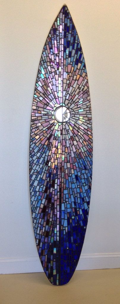 Sunrise mosaic on a real surfboard. Measures 18-1/2 wide x 76 tall. Titled Infinite Possibilities. This one of a kind work of art is made with several colors of stained glass and glass beads, mostly pinks and blues and gradually going from light to dark. Many iridescent colors, it changes with different lighting. A stunning statement piece. This piece is available as is or I can make you a custom piece for your home or business. Made by hand in Ocean City, NJ I will only charge the...