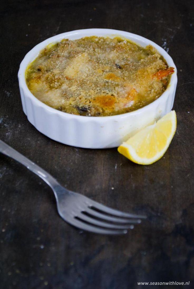 Een vispotje met tilapia en grote garnalen. Heerlijk met een krokante korst uit de oven. Perfect als voorgerecht of tussengerecht!