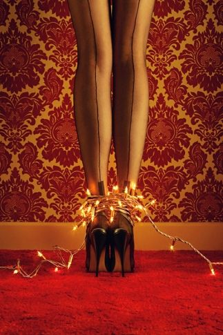 Whoa. The winning photo from Joanna's Wardrobe Leg Art Competition. Sexy. #stockings #twinklelights