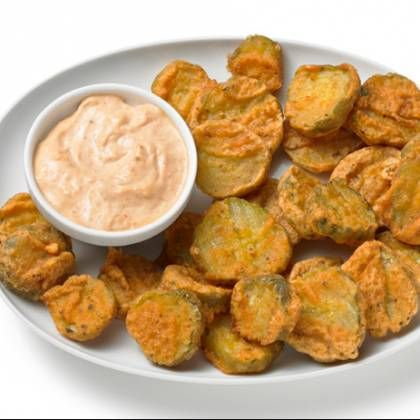 Frying Oil 2 cups all-purpose flour 1 teaspoon salt 1 teaspoon pepper 1 teaspoon sugar 1/4 teaspoon cayenne pepper 2 cups pickle chips Ranch dressing or horseradish sauce