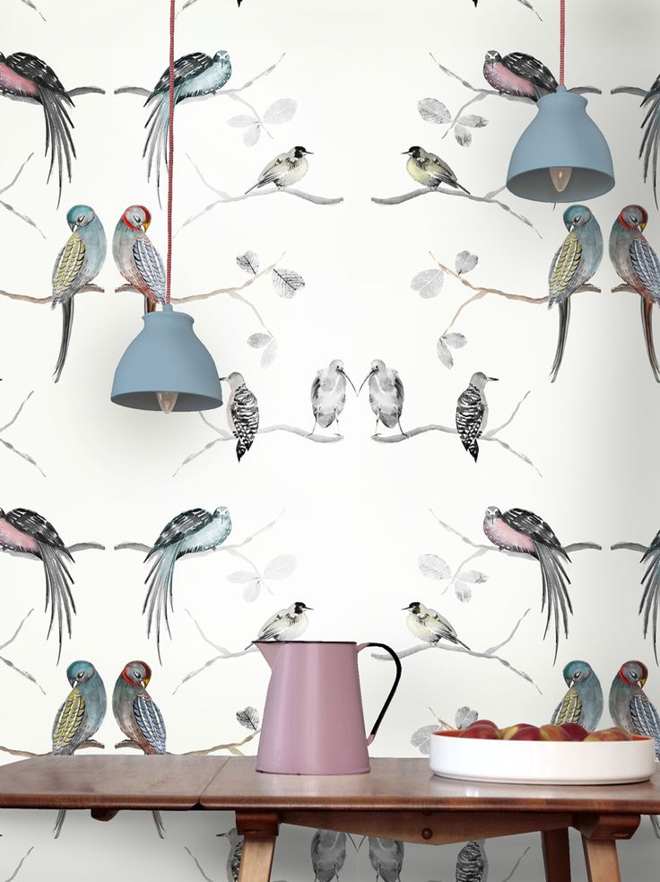 Birds and leaves paintings on a wallpaper design.