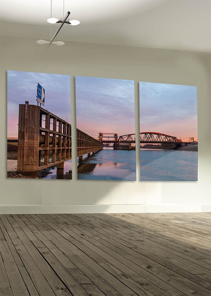 Ijsselbrug in Zutphen - the Netherlands by Tim Abeln Photography and Digital Art Prints. Beautiful wall decoration for your home and office. The bridge in Zutphen, the Netherlands, with a beautiful colored sky at sunrise. #netherlands #zutphen #photography #landscape #bridge #cityscape #wallart #walldecor #interiordesign #giftideas #muurdecoratie