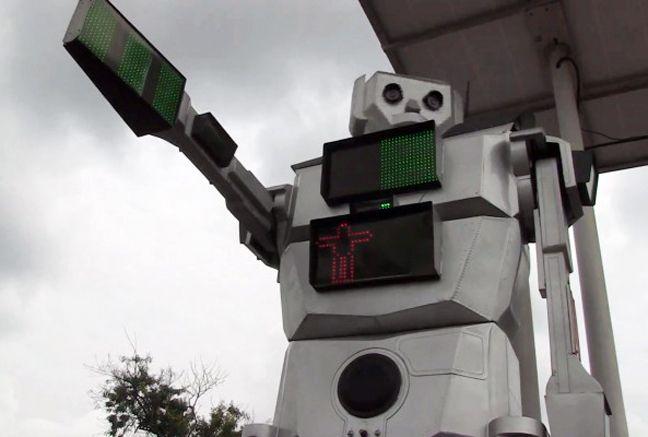 Talking robots take control of kinshasa's traffic.
