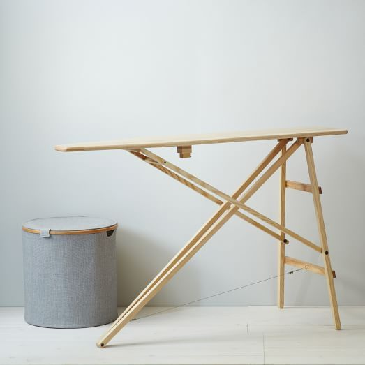 LOL!  I have also had this old ironing board to use, refusing to buy a new one.  It's cool again!  Mid-Century Ironing Board | West Elm