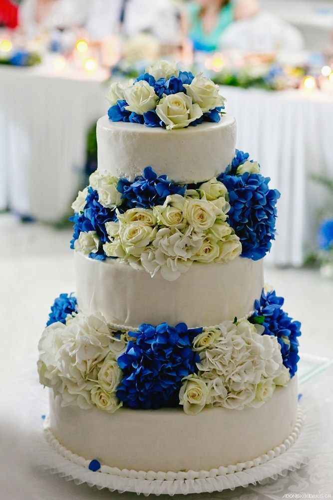 Our pastry Chef cooperates with the florist for a simple yet impressive wedding cake at Mykonos Grand Hotel & Resort