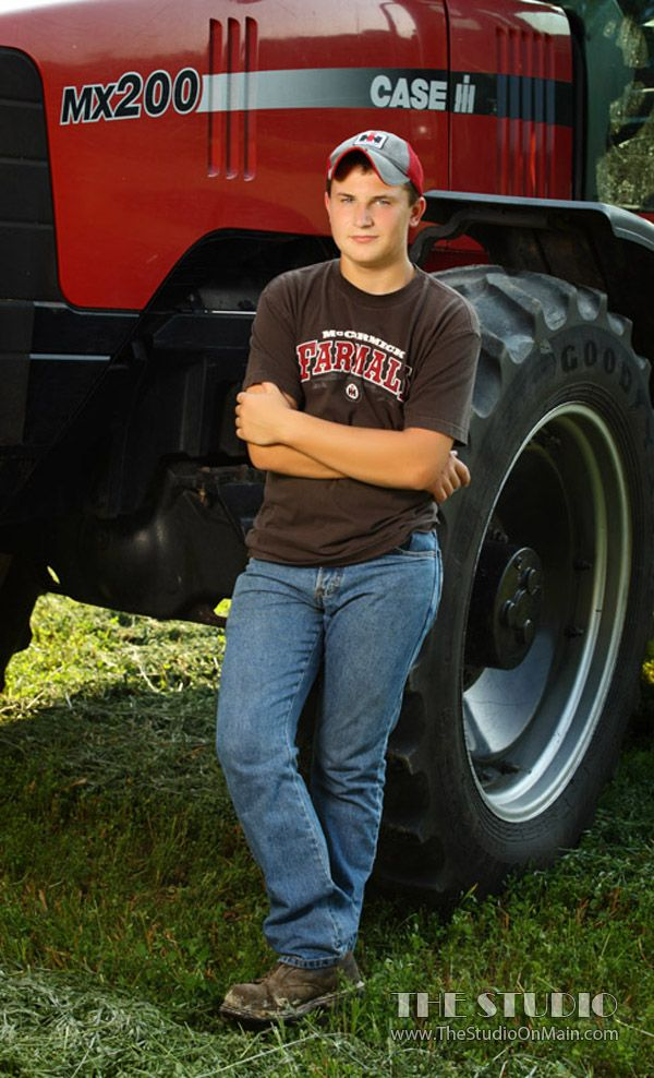 ©The Studio • La Crosse, WI www.TheStudioOnMain.com  Boy • Senior • Pictures • Portraits  Tractor • Farm