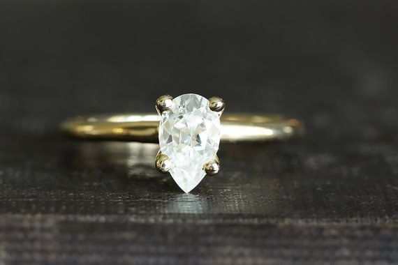 A pear-cut moissanite stunner made from recycled 14k gold.