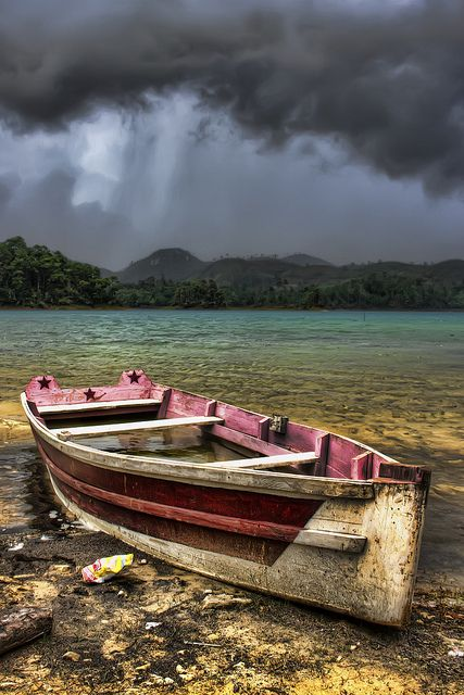 Under the Storm. Great contrast between the boat on the shore and the approaching storm [ HDR ]