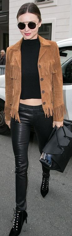 Who made  Miranda Kerr's brown fringe suede jacket, black lace up boots, jewelry, handbag, and sunglasses?