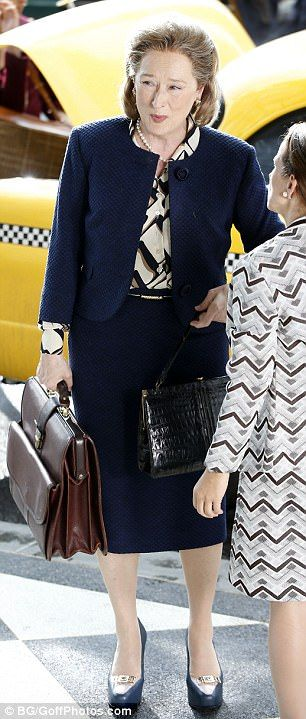 Boss lady: The three-time Oscar winner suited up in a blue blazer, matching pencil skirt, ...