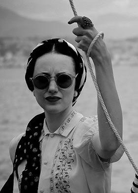 Wallis Simpson...possibly not that cheerful but I like the specs.