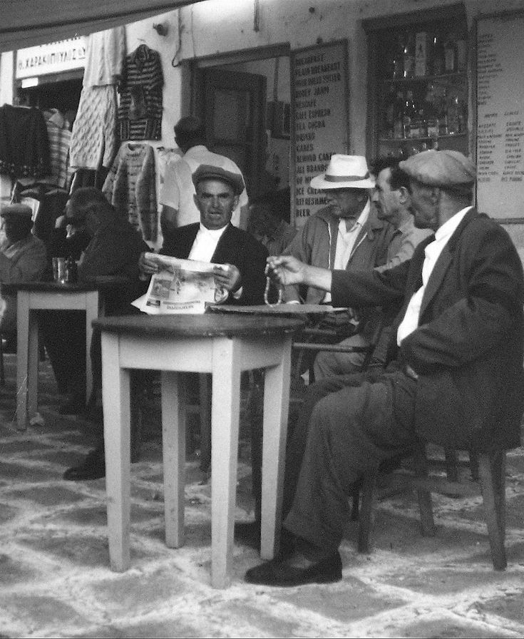 Black and white photograph of Greek restaurant scene by Roz Joseph (b.1926).