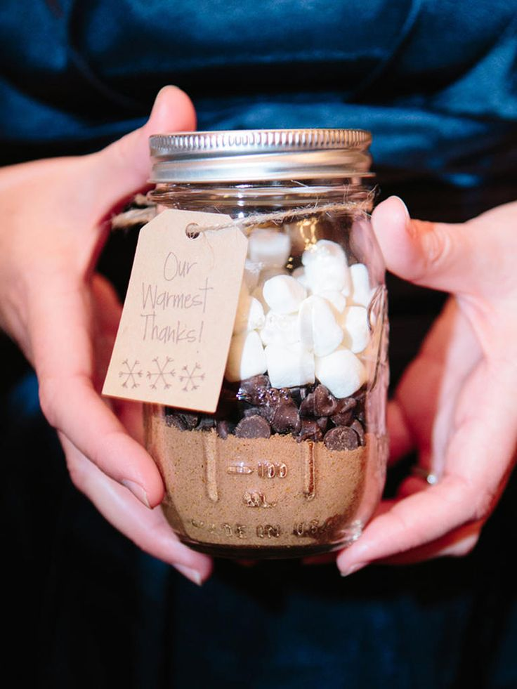 Write your warmest wishes for your guests onto wedding favor labels attached to delicious jars of layered hot chocolate ingredients.