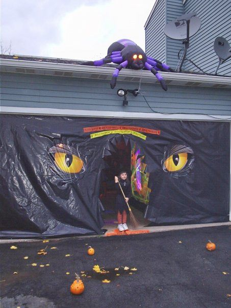 Transform your garage into a haunted (party) house. Add a few props like plastic tombstones, cobwebs, hanging bats and giant spiders, a cauldron full of candy and refreshing witches brew and you've set the stage for a ghoulishly good Halloween get-together for friends and neighbors. Replace the interior light bulbs with orange and black lights and add a fog machine and eerie music to complete the effect.