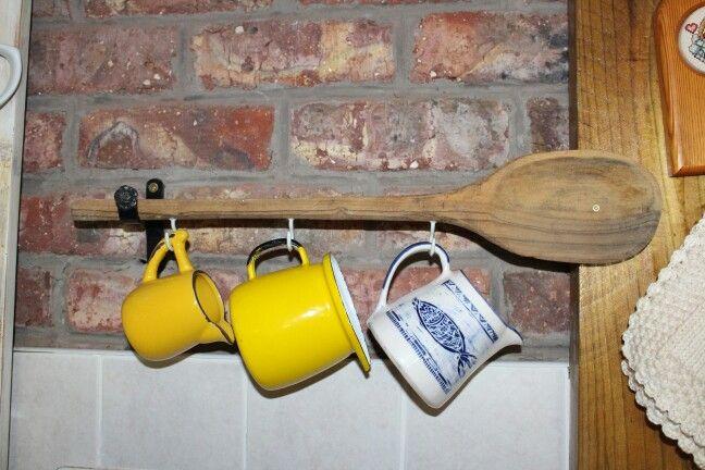 Old wooden spoon madevfor milk jug holders