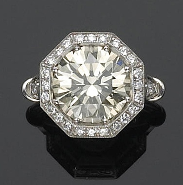 A Diamond And Platinum Solitaire Ring Centering An Old