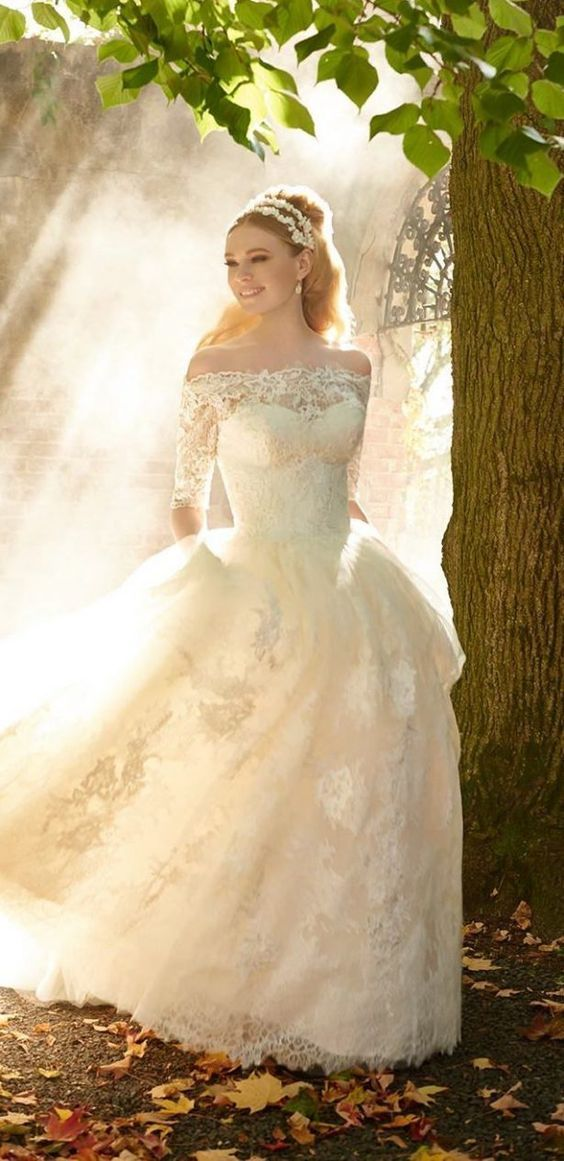 Beautiful lace off-the-shoulder ballgown wedding dress; Featured Dress: Matthew Christopher How lovely!
