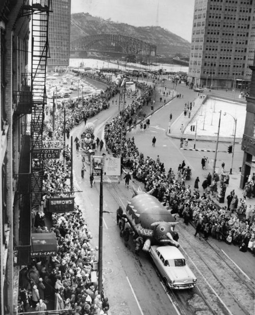 """Nov. 22, 1956: """"Christmas Parade Downtown Pittsburgh""""   Despite 27-degree weather, thousands of people packed Downtown streets to watch the annual Christmas parade during the noon hour on Thursday, Nov. 22, 1956."""
