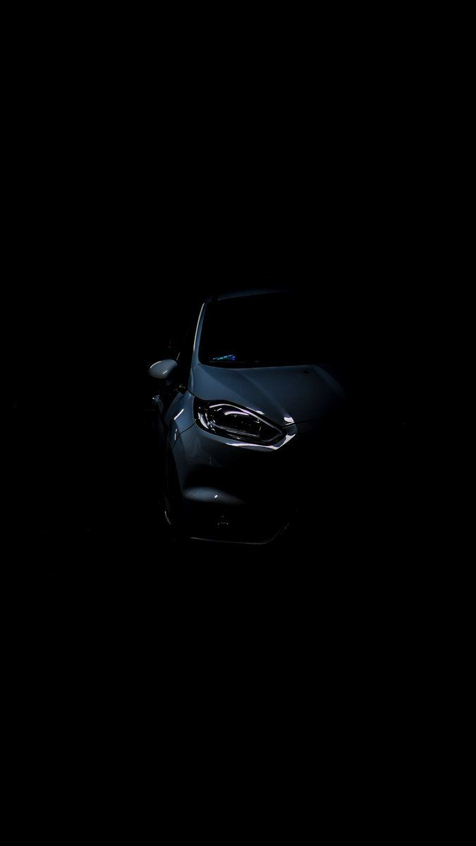 No matter the make or model, this color to many provides the car with a certain sleekness that other colors can't provide. Auto Headlight Dark Background Wallpaper Background Dark Background Wallpaper Dark Backgrounds Dark Wallpaper