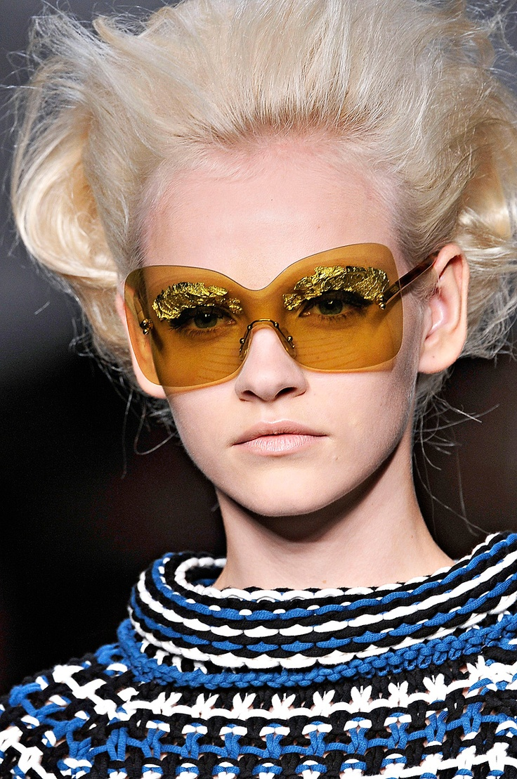 Fendi sunglasses. Maybe the model thought these would cover up her eyelashes made of tin foil...