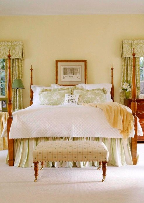 Pale yellow walls set off spring green valances and pillows in this master suite the windows on Master bedroom with yellow walls