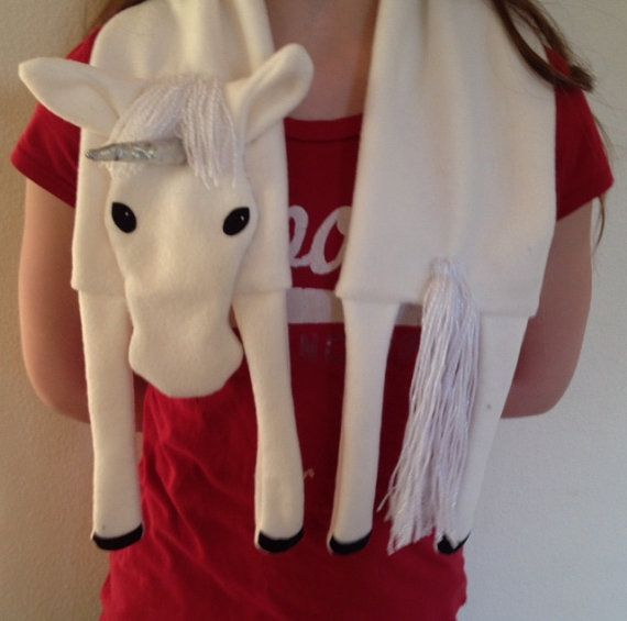 Every princess needs a unicorn! This pattern includes: pattern pieces, full sized photos, and detailed written instructions. Made from fleece this beginner level pattern will be a snap!   Look for these other scarf patterns: Husky, Pug, Dachshund, Boston Terrier, Staffordshire Terrier (Pit Bull), Poodle, Horse, Owl, Fox, Bear, Moose, Alligator, Sock Monkey, Lamb, and Sleepy Kitty