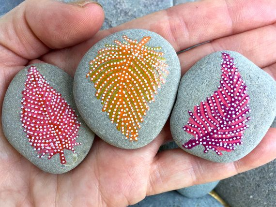 Feather magnets (set of three sea stone magnets)  Fridge magnets. Refrigerator magnets. Art for file cabinets.  Art that sticks.  Bring a piece of the shore...inside.  Delicate, painted feathers dance upon these sea stone magnets in water-resistant glaze inks over paint in colors of soft red, pink and white, tangerine, lemon yellow and white and magenta, pink and white.turquoise, The tiny magnets used on the back of each stone are Super Strong, neodymium-iron-boron Rare Earth magnets.  Add…