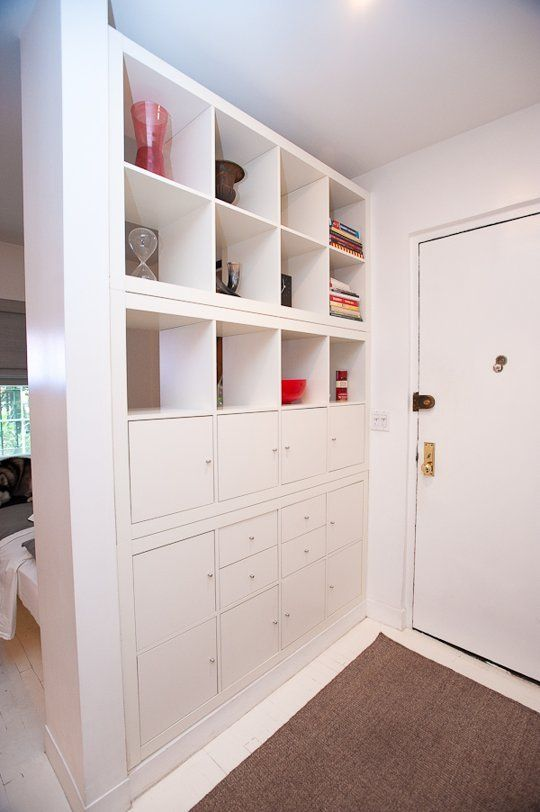 Jay built this entryway unit that creates a separate entryway that also packs in the storage. Since the bed is on the other side, it serves as a headboard too!