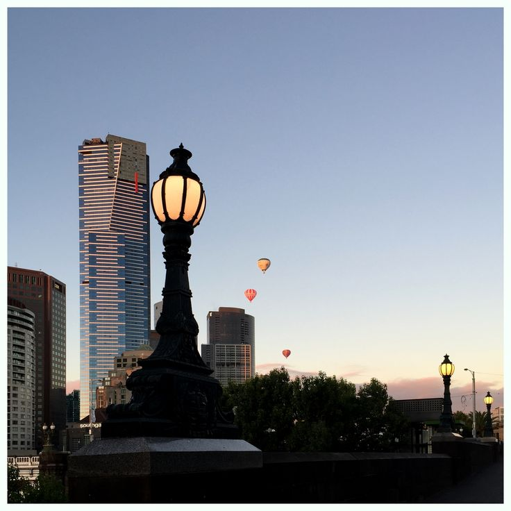 Dawn in Melbourne... old and the new. Lamps still lit along Princes Walk, Melbourne with Eureka Tower and Hot Air Balloons in the background. [7.10am Feb 27, 2015]