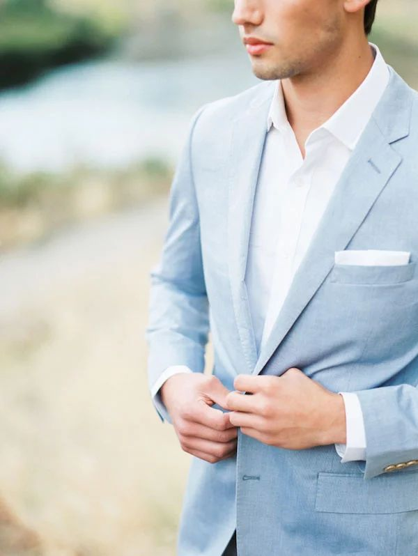 Groomsmen in pastel blue summer suits.