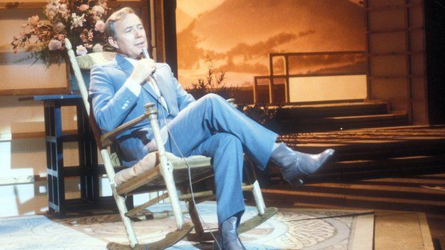 """Irish singer and TV entertainer Val Doonican has died aged 88. His family said he died """"peacefully"""" at a nursing home in Buckinghamshire. He had not been ill, but his daughter said his """"batteries had just run out"""". The performer was a regular fixture on TV with The Val Doonican show which ran on the BBC from 1965 to 1986, featuring his own performances and guest artists."""