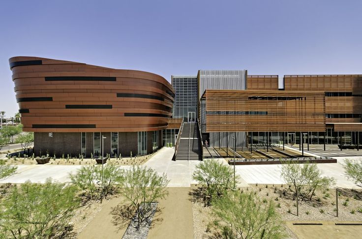 """GateWay Community College / SmithGroup JJR. Phoenix, AZ. The three-story building creates an """"academic city"""" that contributes to a sense of community on campus.A palette of masonry, glass, galvanized metal and copper complements the campus and evolves the language looking towards the future."""