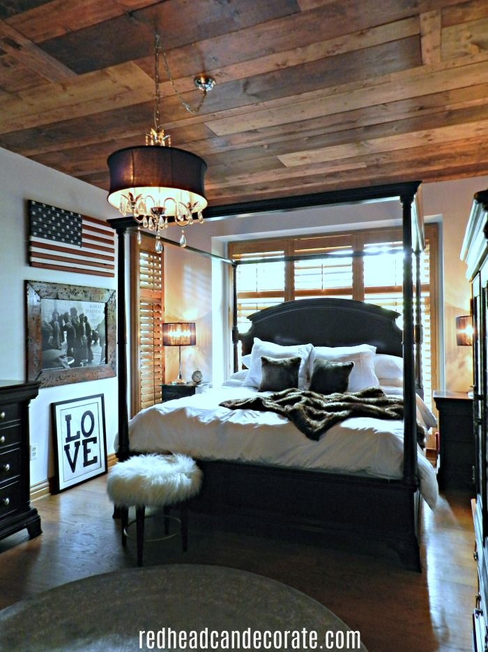 Beautiful rustic patriotic bedroom done by adding boards to the ceiling and a flag on the wall!