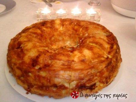 Είναι μια πεντανόστιμη και πανεύκολη τυρόπιτα που με βγάζει ασπροπρόσωπη σε τραπέζια διότι είναι και ευπαρουσίαστη!!!
