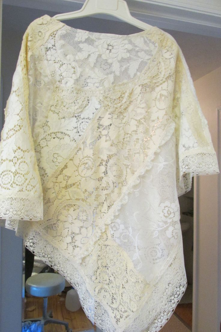 Poncho crazy quilt patched from tail end scraps from vintage lace tablecloths. New thing from old things.....