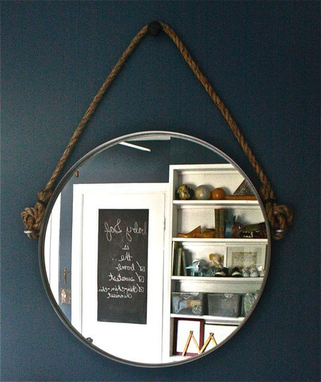 Hang mirror then add ribbon to make it look like its hanging by it off the wall.